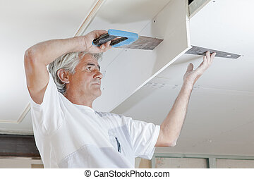 Sawing a ceiling panel