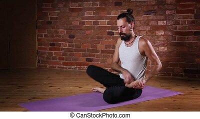 Man meditating in Lotus posture - Serene young Caucasian man...