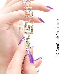 jewelry in woman hands with lilac manicure