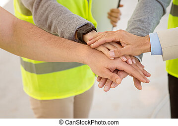 Construction project team. Building industry - As one. Glad...