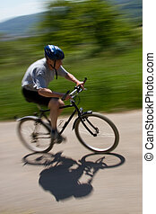 Mountainbiker - Senior cycling on a MTB