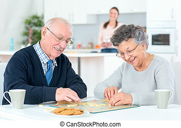 Grandparents playing a board game