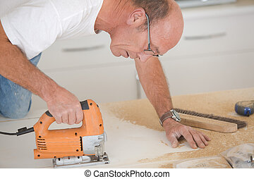 Man using a band saw