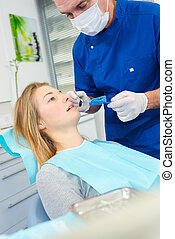 Blond woman in the dentist chair