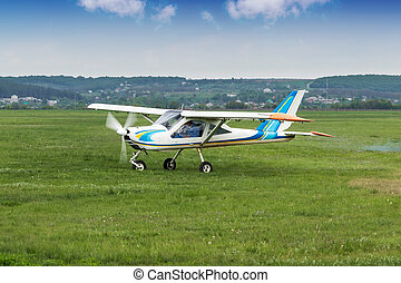 Small business airplane - Small two-seater plane was taxiing...