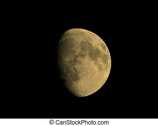 Gibbous moon sepia - Waxing gibbous moon over dark sky at...