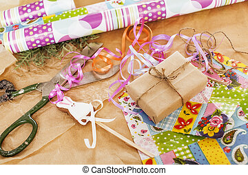 lot of stuff for handmade gifts, scissors, ribbon, paper...