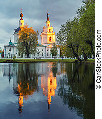 Ortodox church and its reflection in a pond - Russian...