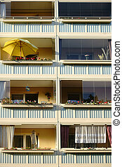 Nostalgic balconies with umbrellas at an old monumental...