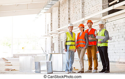 Construction workers. Team of project - Being proud. Happy...