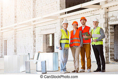 Construction workers. Team of project - Underway. Happy and...