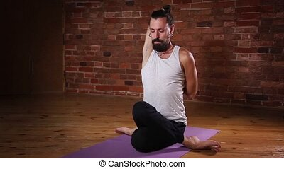 Young man in yoga meditation postur - Young man sitting in...