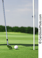 golf field - pictire of golf landscape with golfball and...