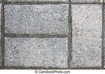 Paver Bricks - Closeup of three paver bricks in a paved...