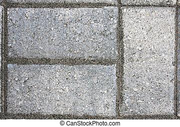 Paver Bricks - Closeup of three paver bricks in a paved...