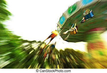 fun in theme park abstract motion blur