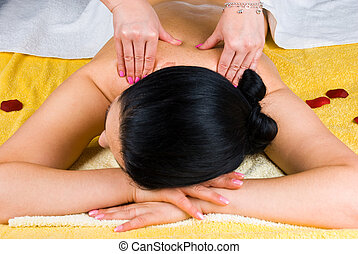 Shoulders massage - Brunette woman at spa salon getting a...