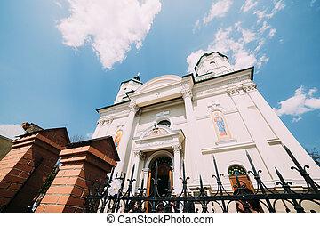 Low angle view of eastern european church with pointy fence under blue sky