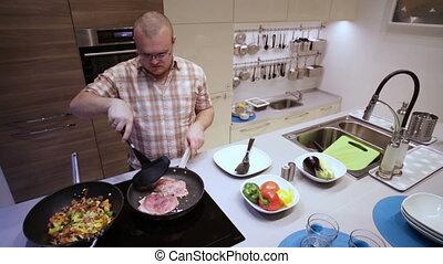 Man Frying Meat in a Pan