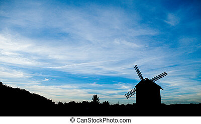 mill and blue sky - windmill on the field and blue cloudy...