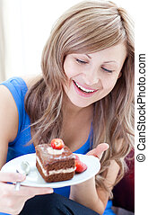 A woman holding a piece of cake