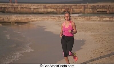 1-Slow motion Girl Sports Training Running On Beach - Young...
