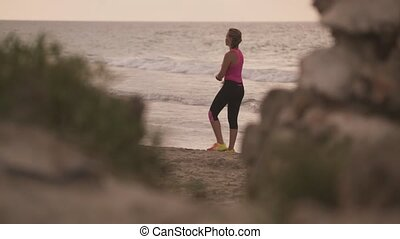 2-Slow motion Woman Sports Training Stretching On Beach -...