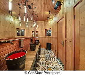 Washroom in mexican restaurant - Washroom with wooden walls...