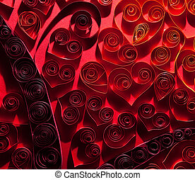 Pretty red hearts made of twisted paper