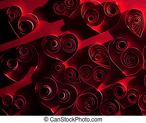 Quilling. Very beautiful red hearts made ??of twisted paper.