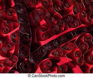 Quilling. Beautiful red hearts made of twisted paper.