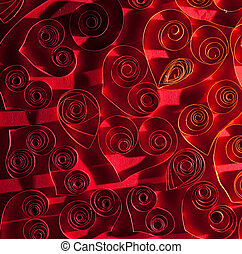 Quilling. Nice red hearts made ??of twisted paper.