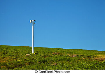 Anemometer in the park against the blue sky