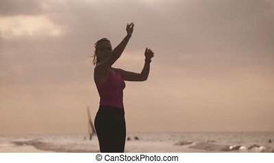 3-Slow motion Fitness Active Girl Stretching On Beach -...