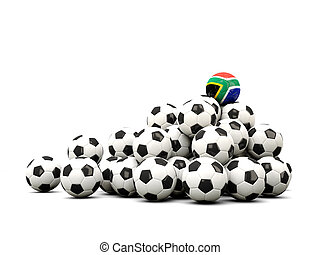 Pile of soccer balls with flag of south africa