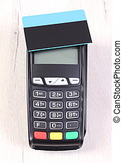 Payment terminal with contactless credit card on wooden...