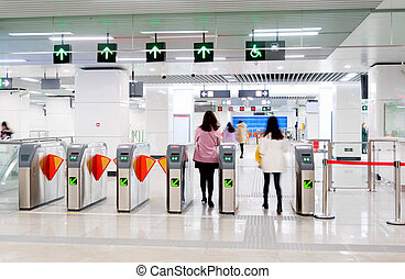 Subway station pedestrian access gates - Passengers in the...