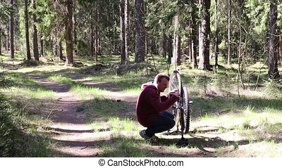 Man Repairing a Transmission of Bicycle - The Man Repairing...