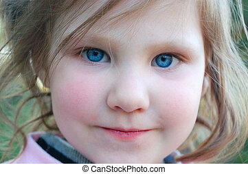 Little girl with rosy cheeks and blue eyes - Portrait of...