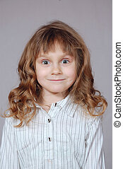 Cute smiling pop-eyed girl with curly hair - cute little...