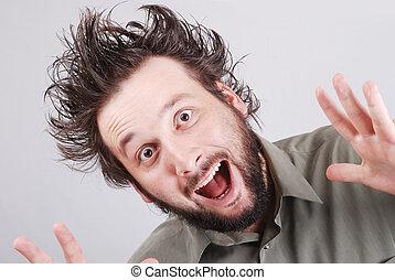 crazy young businessman facial expression