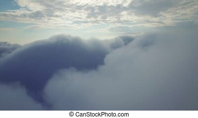 aerial view above the clouds - flying above the clouds in...