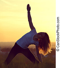young woman stretching - Silhouette of young woman...