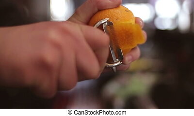 Bartender make citrus garnish on the bar slo-mo