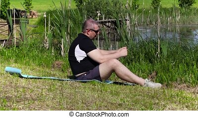 Man talking on smart phone and relax near lake