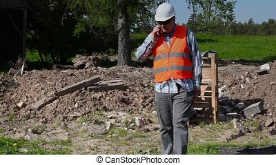 Builder walking and talking