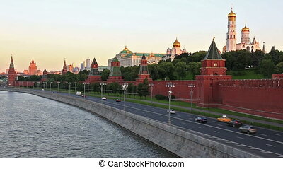 Cars go on the embankment along the Kremlin wall in Moscow