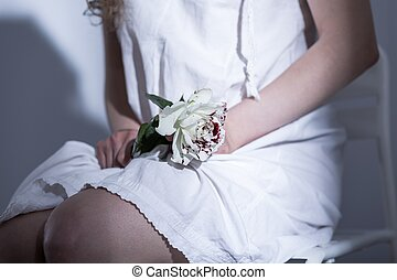 Symbolic farewell to her lost innocence - Close-up of a...