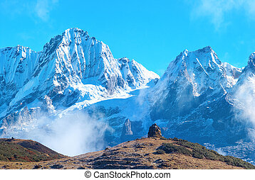 Peaks of mountains, covered by snow - Peaks of high...