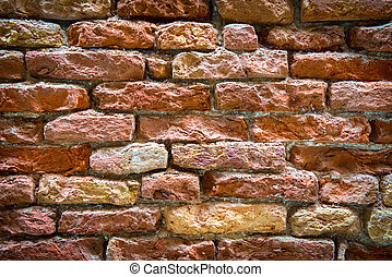 Old brick wall on the street of Venice, Italy